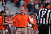 Head Coach Mike Gundy of the Oklahoma State Cowboys questions a call in the second half against the Baylor Bears on October 29, 2011 at Boone Pickens Stadium in Stillwater, Oklahoma.  Oklahoma State defeated Baylor 59-24.