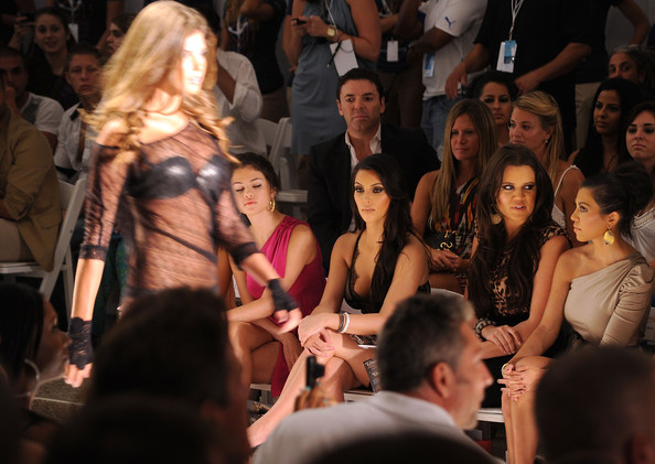 Selena Gomez (L-R) Selena Gomez, Kim Kardashian, Khloe Kardashian and Kourtney Kardashian attend the Beach Bunny Swimwear 2011 fashion show during Mercedes-Benz Fashion Week Swim at the Raleigh on July 16, 2010 in Miami Beach, Florida.