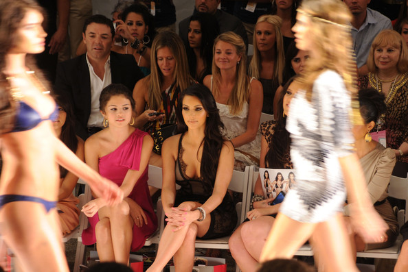 Selena Gomez (L-R) Selena Gomez and Kim Kardashian attend the Beach Bunny Swimwear 2011 fashion show during Mercedes-Benz Fashion Week Swim at the Raleigh on July 16, 2010 in Miami Beach, Florida.