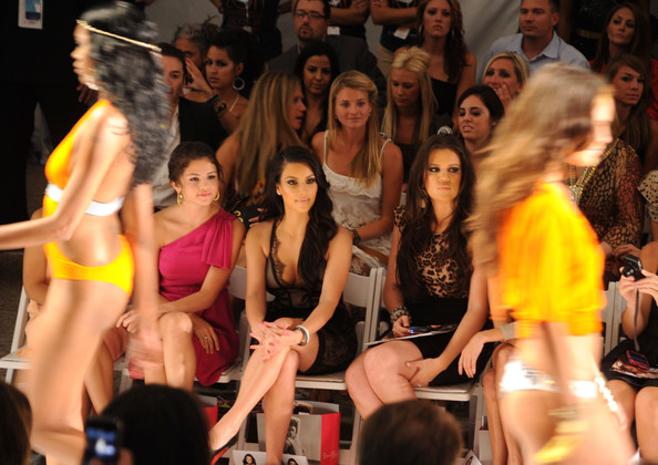 Selena Gomez (L-R) Selena Gomez, Kim Kardashian and Khloe Kardashian attend the Beach Bunny Swimwear 2011 fashion show during Mercedes-Benz Fashion Week Swim at the Raleigh on July 16, 2010 in Miami Beach, Florida.