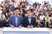 """Actor Ryuhei Matsuda and  Director Kiyoshi Kurosawa attend the """"Before We Vanish (Sanpo Soru Shinryakusha)"""" photocall during the 70th annual Cannes Film Festival at Palais des Festivals on May 21, 2017 in Cannes, France."""