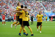 Thomas Meunier of Belgium celebrates with team mates Nacer Chadli and Kevin De Bruyne after scoring his team's first goal  during the 2018 FIFA World Cup Russia 3rd Place Playoff match between Belgium and England at Saint Petersburg Stadium on July 14, 2018 in Saint Petersburg, Russia.