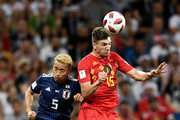 Yuya Osako of Japan wih over Yuto Nagatomo of Japan during the 2018 FIFA World Cup Russia Round of 16 match between Belgium and Japan at Rostov Arena on July 2, 2018 in Rostov-on-Don, Russia.