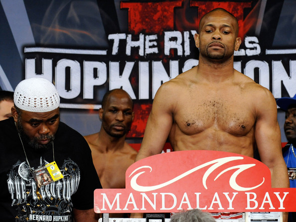 Boxer Roy Jones Jr. (R) weighs in as Bernard Hopkins (C) and his trainer Nazim Richardson (L) look at the scale during the official weigh-in for their bout at the Mandalay Bay Events Center April 2, 2010 in Las Vegas, Nevada. The fighters will meet in a light heavyweight bout on April 3 in Las Vegas.