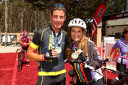 Professional cyclist George Hincapie (L) and Best Buddies Challenge Event Co-Chair Maria Shriver pose at the finish line of the Best Buddies Challenge Hearst Castle at Hearst Ranch on September 6, 2014 in San Simeon, California.