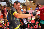 Professional cyclist George Hincapie (L) and Best Buddies Challenge Event Co-Chair Maria Shriver take a selfie at the finish line of the Best Buddies Challenge Hearst Castle at Hearst Ranch on September 6, 2014 in San Simeon, California.