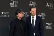 Germany Manager, Joachim Low (L) and former Germany player Oliver Bierhoff arrives on the Green Carpet ahead of The Best FIFA Football Awards at Royal Festival Hall on September 24, 2018 in London, England.