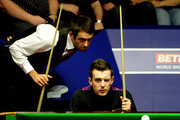 Ronnie O'Sullivan of England and Mark Selby of England show interest as Referee Leo Scullion (not pictured) replaces the balls after a foul shot, during their Quarter Final match in the Betfred.com World Snooker Championships, at The Crucible Theatre on April 28, 2010 in Sheffield, England.