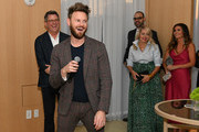 Designer Bobby Berk (2L) speaks as Better Homes & Gardens Editor in Chief, Stephen Orr (L) and guests look on during cocktail hour at Better Homes & Gardens Stylemaker 2019 at PUBLIC Hotel on September 19, 2019 in New York City.