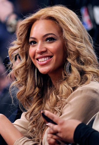 Beyonce Knowles Singer Beyonce Knowles sits in the audience during the 2011 NBA All-Star game at Staples Center on February 20, 2011 in Los Angeles, California. NOTE TO USER: User expressly acknowledges and agrees that, by downloading and or using this photograph, User is consenting to the terms and conditions of the Getty Images License Agreement.