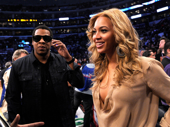 Beyonce Knowles Jay-Z (L) and singer Beyonce Knowles speak during the 2011 NBA All-Star game at Staples Center on February 20, 2011 in Los Angeles, California. NOTE TO USER: User expressly acknowledges and agrees that, by downloading and or using this photograph, User is consenting to the terms and conditions of the Getty Images License Agreement.