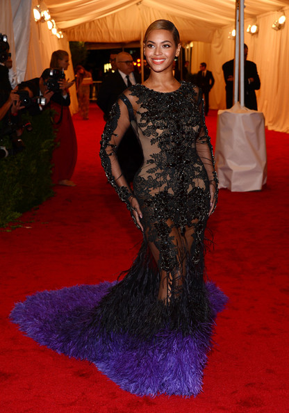 """NY: """"Schiaparelli And Prada: Impossible Conversations"""" Costume Institute Gala [flooring,carpet,gown,dress,red carpet,beauty,lady,fashion,shoulder,fashion model,schiaparelli and prada: impossible conversations costume institute gala,ny,metropolitan museum of art,beyonce knowles]"""