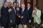 Israeli President Shimon Peres (C) is presented with the Congressional Gold Medal during a ceremony at the U.S. Capitol, June 26, 2014 in Washington, DC. Also pictures are (L-R) Vice President Joseph Biden, Senate Majority Leader Harry Reid (D-NV), House Speaker John Boehner (R-OH), Senate Minority Leader Mitch McConnell (R-KY), President Shimon Peres, outgoing House Majority Leader Eric Cantor (R-VA), House Minority Leader Nancy Pelosi (D-CA)