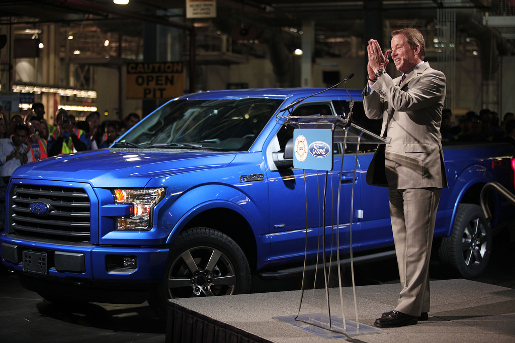 Bill ford in top ford executives hold press conference for Ford motor company executives