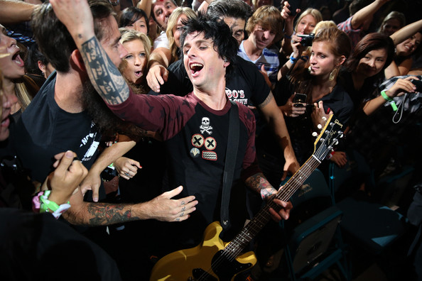 Billie Joe Armstrong Frontman Billie Joe Armstrong of Green Day performs in the crowd during the 2012 iHeartRadio Music Festival at the MGM Grand Garden Arena on September 21, 2012 in Las Vegas, Nevada.