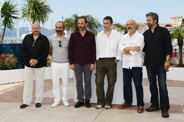 "(L-R) Actors Ahmet Mumtaz Taylan, Yilmaz Erdogan, Muhammet Uzuner, director Nuri Bilge Ceylan, Ercan Kesal and Taner Birsel attend the ""Bir Zamanlar Anadolu'Da"" Photocall at Palais des Festivals during the 64th Annual Cannes Film Festival on May 21, 2011 in Cannes, France."