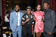 """(L-R) Actor John David Washington, director Spike Lee, and actors Laura Harrier and Corey Hawkins attend the after party for the New York premiere of """"BlacKkKlansman"""" at the BAM Lepercq Space on July 30, 2018 in the Brooklyn borough of New York City."""