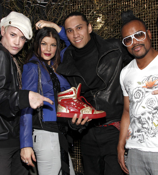 (L-R) Designer Richie Rich with musicians Fergie, Taboo, and apl.de.ap of The Black Eyed Peas attend the Jump Footwear Launch TABOOXJUMP at Juliet on November 12, 2009 in New York City.