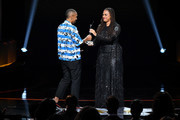 Lena Waithe accepts an award from Ava DuVernay onstage during the Black Girls Rock! 2018 Show at NJPAC on August 26, 2018 in Newark, New Jersey.