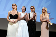 (L-R) Actresses Emma Watson, Katie Chang, Taissa Farmiga and Claire Julien attend 'The Bling Ring' premiere during The 66th Annual Cannes Film Festival at the Palais des Festivals on May 16, 2013 in Cannes, France.