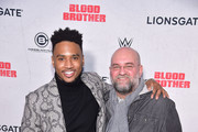 "Trey Songz and director John Pogue attend the ""Blood Brother"" New York Screening at Regal Battery Park 11 on November 29, 2018 in New York City."