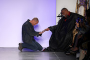 Nigel Barker kneels before André Leon Talley on the runway at The Blue Jacket Fashion Show during NYFW at Pier 59 Studios on February 05, 2020 in New York City.