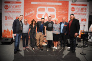 (L-R) Mark Pastore, Lee Schrager, Rachael Ray, Marc Murphy, Anne Burrell, Andrew Zimmern, Nick Mangold and Adam Richman pose for a photo at the Blue Moon Burger Bash presented by Pat LaFrieda Meats hosted by Rachael Ray during the New York City Wine & Food Festival at Esurance Rooftop Pier 92 on October 17, 2014 in New York City.