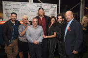(L-R) Adam Richman, Anne Burrell, Lee Brian Schrager, Nick Mangold, Rachael Ray, John Cusimano and Andrew Zimmern pose in front of the judges table at the Blue Moon Burger Bash presented by Pat LaFrieda Meats hosted by Rachael Ray during the New York City Wine & Food Festival at Esurance Rooftop Pier 92 on October 17, 2014 in New York City.