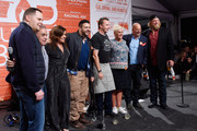 (L-R) Chef Mark Pastore, NYCWFF founder and director Lee Schrager, TV Personality Rachael Ray, TV Personality Adam Richman, Chef Marc Murphy, Chef Anne Burrell, TV Personality Andrew Zimmern and professional football player Nick Mangold pose for a photo at the Blue Moon Burger Bash presented by Pat LaFrieda Meats hosted by Rachael Ray during the New York City Wine & Food Festival at Esurance Rooftop Pier 92 on October 17, 2014 in New York City.