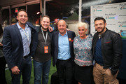 (From 2nd L) Mark Pastore, Andrew Zimmern, Anne Burrell, and Adam Richman pose at the Blue Moon Burger Bash presented by Pat LaFrieda Meats hosted by Rachael Ray during the New York City Wine & Food Festival at Esurance Rooftop Pier 92 on October 17, 2014 in New York City.