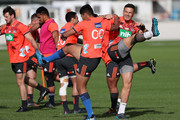 Blues player Rieko Ioane (L) warms up with Sonny Bill Williams (R) during a Blues training session on April 18, 2018 in Auckland, New Zealand.