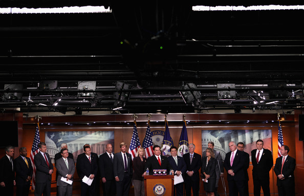 House Republican Freshman Hold News Conference Urging Senate To Pass Budget [red,event,suit,formal wear,technology,night,team,official,ceremony,tuxedo,scott rigell,allen west,bob gibbs,jeff landry,francisco canseco,rob woodall,senate to pass budget,tx,republican,house of representatives]