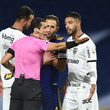 Andres Rojas and Atletico MG argue