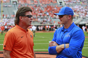 Head Coach Mike Gundy of the Oklahoma State Cowboys and Head Coach Bryan Hardin of the Boise State Broncos meet before the game at Boone Pickens Stadium on September 15, 2018 in Stillwater, Oklahoma. The Cowboys defeated the Broncos 44-21.
