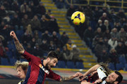 Panagiotis Kone # 33 of Bologna FC (L) competes the ball with Andrea Lazzari # 21 of Udinese Calcio during the Serie A match between Bologna FC and Udinese Calcio at Stadio Renato Dall'Ara on February 1, 2014 in Bologna, Italy.