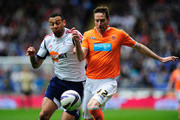 Blackpool player Kirk Broadfoot (r) challenges Bolton player Craig Davies during the npower Championship match between Bolton Wanderers and Blackpool at Reebok Stadium on May 4, 2013 in Bolton, England.