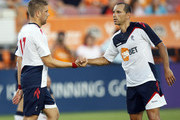 Ivan Klasnic #17 of Bolton is congratulated by teammate Martin Petrov #10 after scoring in the first half against the Houston Dynamo at Robertson Stadium on July 20, 2011 in Houston, Texas.