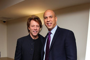 Musican Jon Bon Jovi (L) and City of Newark Mayor Cory Booker attend the opening of affordable housing funded through Bon Jovi's JBJ Soul Foundation on December 8, 2009 in Newark, New Jersey.
