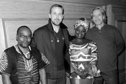 This image has been converted to black and white. A color version is available) (L-R) Fidel Bafilemba, Ryan Gosling, Chouchou Namegabe and John Prendergast attend the discussion and signing for 'Congo Stories' at The West Hollywood Library on December 10, 2018 in West Hollywood, California.