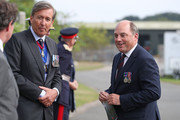 Defence Secretary Ben Wallace (right) arrives to attend the national service of remembrance marking the 75th anniversary of VJ Day at the National Memorial Arboretum on August 15, 2020 in Alrewas, England.  Saturday marks 75 years since Japan surrendered to the Allied forces on August 15 1945, ending the conflict's hostilities.