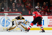 Anton Khudobin #35 of the Boston Bruins stops a first-period penalty shot from Travis Zajac #19 of the New Jersey Devils during the first period at Prudential Center on February 11, 2018 in Newark, New Jersey.