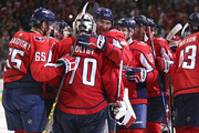 Alex Ovechkin #8 of the Washington Capitals celebrates with teammate Braden Holtby #70 after defeating the Boston Bruins at Capital One Arena on December 28, 2017 in Washington, DC.