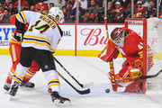 Chris Wagner #14 of the Boston Bruins shoots the puck on Mike Smith #41 of the Calgary Flames during an NHL game at Scotiabank Saddledome on October 17, 2018 in Calgary, Alberta, Canada.