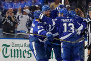 Members of the Tampa Bay Lightning, from left, Ryan Callahan #24, Victor Hedman #77, Cedric Paquette #13 and Chris Kunitz #14 celebrate a goal against the Boston Bruins during the third period of the game at the Amalie Arena on April 3, 2018 in Tampa, Florida. (Photo by Mike Carlson/Getty Images) *** Local Caption *** Ryan Callahan;Victor Hedman;Chris Kunitz;Cedric Paquette