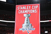 Alex Ovechkin #8 of the Washington Capitals and teammates pose for a photo before their 2018 Stanley Cup Championship banner rises to the rafters before playing against the Boston Bruins at Capital One Arena on October 3, 2018 in Washington, DC.
