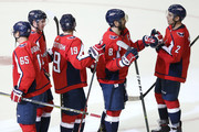 Alex Ovechkin #8 of the Washington Capitals celebrates with teammates after defeating the Boston Bruins at Capital One Arena on October 3, 2018 in Washington, DC.