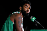 Kyrie Irving #11 answers questions during a press conference on Boston Celtics Media Day on September 24, 2018 in Canton, Massachusetts.