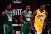 Julius Randle #30 of the Los Angeles Lakers celebrates after his dunk in front of Marcus Smart #36 and Al Horford #42 of the Boston Celtics during a 108-107 Lakers win at Staples Center on January 23, 2018 in Los Angeles, California.