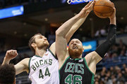 Tyler Zeller #44 of the Milwaukee Bucks blocks a shot by Aron Baynes #46 of the Boston Celtics but gets called for a foul during Game Four of Round One of the 2018 NBA Playoffs at the Bradley Center on April 22, 2018 in Milwaukee, Wisconsin. NOTE TO USER: User expressly acknowledges and agrees that, by downloading and or using this photograph, User is consenting to the terms and conditions of the Getty Images License Agreement.