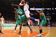 Carmelo Anthony #7 of the New York Knicks shoots over Kevin Garnett #5 of the Boston Celtics during Game two of the Eastern Conference Quarterfinals of the 2013 NBA Playoffs at Madison Square Garden on April 23, 2013 in New York City.  NOTE TO USER: User expressly acknowledges and agrees that, by downloading and or using this photograph, User is consenting to the terms and conditions of the Getty Images License Agreement.